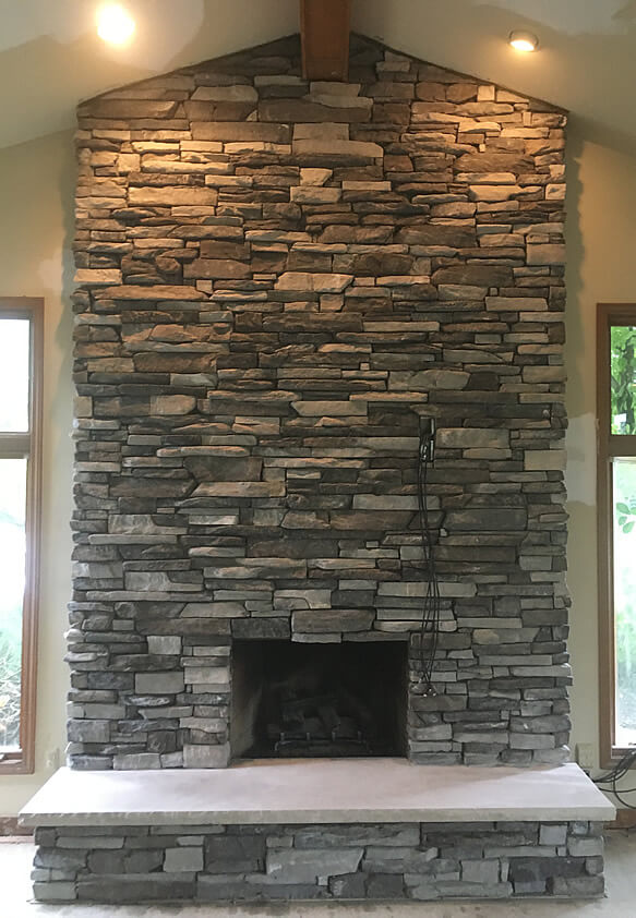 Custom Stone Fireplaces. Masonry Contractor  Brixnstone LLC services all of SE Michigan and Metro Detroit with exceptional custom stone work backyard living areas brick fireplace company bloomfield mi